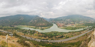 Confluence of Mtkvari Kura and Aragvi rivers with the Mtskheta city on the bank, Georgia Stock Photo