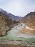 Confluence of river Indus and Zanskar Stock Photos
