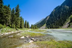 Confluence of rivers on mountain road. Kyrgyzstan Stock Photo
