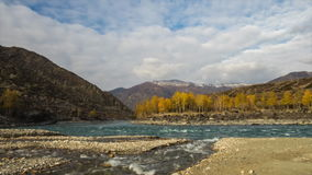 Confluence of two rivers in mountains. Autumn, gold hour light. Movement of rivers and clouds. stock video footage