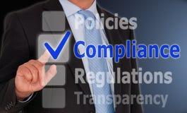 Conformité d'affaires sur l'écran tactile Image stock