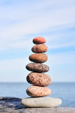 Confront. Different amounts of colored pebble as the pyramid Stock Photo