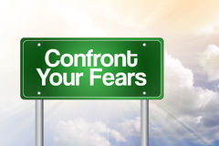 Confront Your Fears Green Road Sign Stock Photo