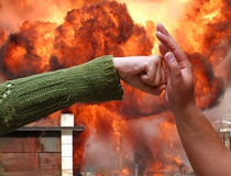Confrontation. Hands resist each other in a fire Royalty Free Stock Photo