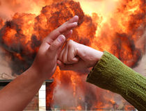 Confrontation. Hands resist each other in a fire Stock Image