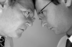 Confrontation. Two businessman from different generations. Conflict of powers royalty free stock images