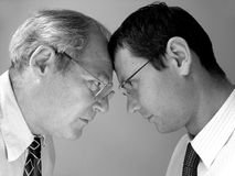 Confrontation. Two businessman from different generations. Conflict of powers stock images