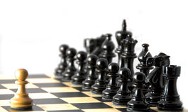 Confrontation against black ranks. Chess. Various chess metaphors. Focus on white pawn Royalty Free Stock Photo