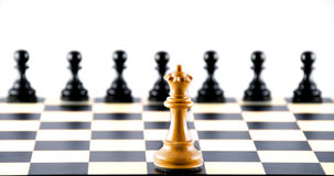 Confrontation against pawns. Chess. Royalty Free Stock Photography