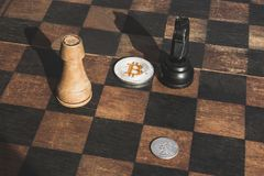 The confrontation between bitcoin and traditional money, concept royalty free stock photography