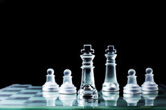 Confrontation - Chess king standing against each other on a ches Stock Images