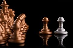 Confrontation between chess pawns Royalty Free Stock Images