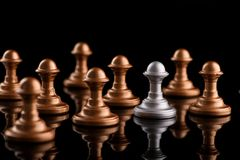 Confrontation between chess pawns Royalty Free Stock Photo
