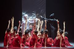 """Confrontation between ideal and desire-Mirror curtain-Huang Mingliang`s dance""""No shelter"""". Huang Mingliang`s dance""""No shelter"""",Young dancers from Royalty Free Stock Photography"""