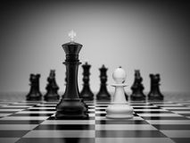 Confrontation king and pawn. On chessboard Stock Images