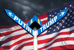 Confrontation between Russia and America. The names of Presidents Putin and Trump on the roadside sign on the background of the American flag and a stormy sky Stock Photo