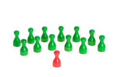 Confrontation. Some figurines in different colors as symbol for teamwork, but also confrontation Stock Photos