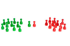 Confrontation. Some figurines in different colors as symbol for teamwork, but also confrontation Royalty Free Stock Photos