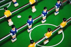 Confrontation. Table football. Close up of plastic table football game. Stock Photo
