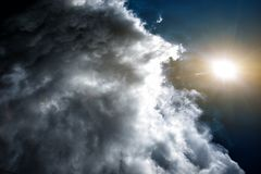 Confrontation of the weather: the sun and the clouds. Concept: the confrontation between people royalty free stock photography