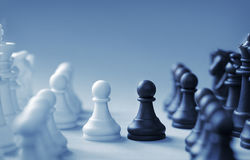 Confronting black and white chess pieces on a light blue background. With slight set shadow Stock Photo