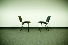 Confronting chairs. Two chairs in office facing each other royalty free stock images