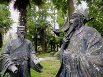 Confucian Scholars. Statues of Confucian scholars in a park in China stock image
