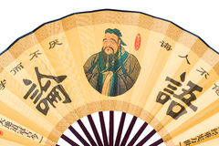 Confucius portrait on Chinese fan (clipping path!). Confucius and his analects on the chinese fan with clipping path Stock Images