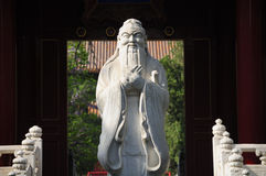 Confucius Stone Statue Beijing China. A carved white stone statue of Confucius within the entrance to Confucius Temple in Beijing China Stock Image