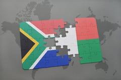confunda com a bandeira nacional de África do Sul e de madagascar em um mapa do mundo Foto de Stock