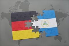 confunda com a bandeira nacional de Alemanha e de Nicarágua em um fundo do mapa do mundo Imagens de Stock Royalty Free
