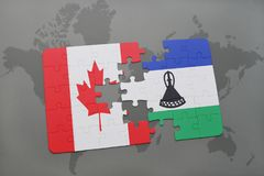 confunda com a bandeira nacional de Canadá e de lesotho em um fundo do mapa do mundo Fotos de Stock Royalty Free