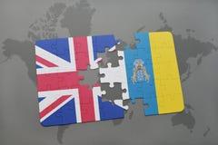 confunda com a bandeira nacional de Grâ Bretanha e de Ilhas Canárias em um fundo do mapa do mundo Fotografia de Stock Royalty Free