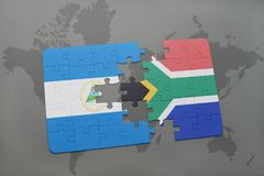 confunda com a bandeira nacional de Nicarágua e de África do Sul em um mapa do mundo Fotografia de Stock