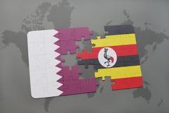 confunda com a bandeira nacional de qatar e de uganda em um fundo do mapa do mundo Imagens de Stock Royalty Free