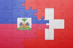 confunda com a bandeira nacional de switzerland e de haiti imagem de stock royalty free