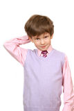 The confuse boy in a pink shirt stock photo