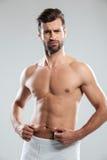 Confused молодой человек неудовлетворенный с избыточным весом Стоковое фото RF