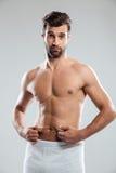 Confused молодой человек неудовлетворенный с избыточным весом Стоковые Изображения RF