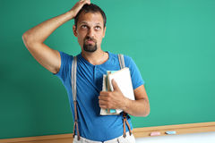 Confused adult student remember something. stock image