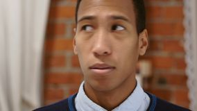 Confused Afraid Handsome African Man Close Up. 4k , high quality stock footage