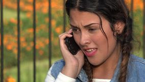 Confused Angry Teen Girl On Cell Phone stock video footage