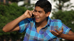 Confused Or Angry Teen Phone Call Royalty Free Stock Photos