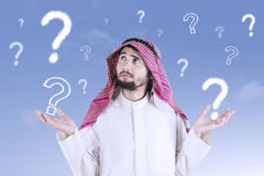 Confused Arabic man with question mark Royalty Free Stock Image