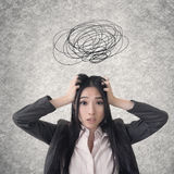 Confused Asian business woman Royalty Free Stock Images