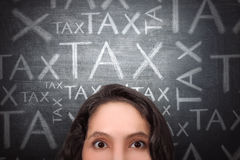 Confused asian business woman with tax announcement Royalty Free Stock Image