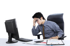Confused asian businessman isolated Royalty Free Stock Photo