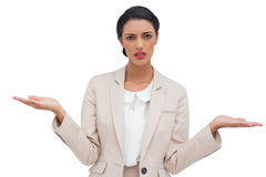 Confused attractive businesswoman. On white background Royalty Free Stock Photo