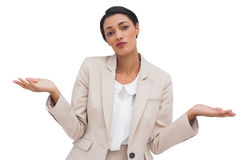 Confused attractive young businesswoman. On white background Stock Photo