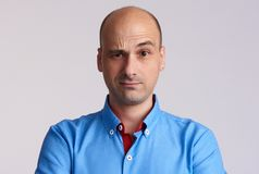 Confused bald man raised eyebrow. Royalty Free Stock Photography